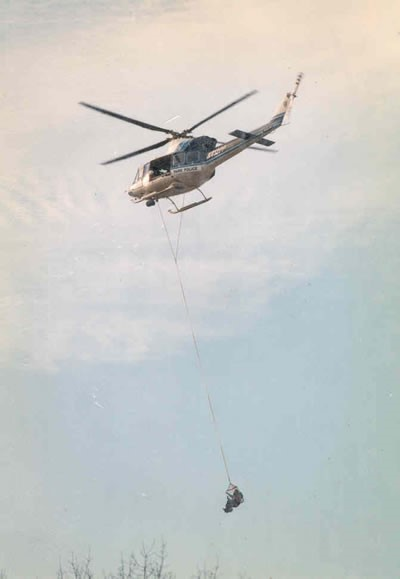 Helicopter evacuates hiker using lift basket