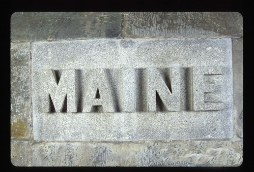 A 2' x 4' commemorative stone that says MAINE on it.