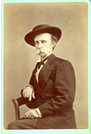 "Lieutenant Colonel George Armstrong Custer in Civilian Dress. LIBI_00019_00280; Item 1 is an original albumen cabinet card of Lieutenant Colonel George A. Custer in civilian dress.  The subject is shown in three-quarter length seated view.  The photograph is 4 x 6"" (4 1/4 x 6 1/2"" mounted on mint green mount with gilded edge) and was produced circa 1874 by Huntington of Taylor's Gallery in St. Paul, Minnesota.  On the verso, a handwritten notation in pencil reads, ""Taken at St. Paul June 1874.""  The photographer's stamp is printed in gold ink.Item 2 is an enlarged a reproduction print of the albumen cabinet card of Lieutenant Colonel George A. Custer in civilian dress.  This black-and-white silver gelatin photograph is 8 x 10"".Note: ""Pkg 4"" handwritten on the verso;Photograph reprinted in ""The Custer Album"" by Lawrence A. Frost, page 67, and ""Custer in Photographs"" by D. Mark Katz, page 112.; Cabinet CARD [Card photograph]; Print, Photograph [Reproduction]; Courtesy of the National Park Service, Little Bighorn Battlefield National Monument, LIBI_00019_00280, Huntin"