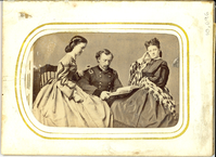 "Ms. Cora Bean, George Armstrong Custer and Elizabeth Bacon Custer Seated with an Open Book. LIBI_00295_10696; A photograph. This image depicts Cora Bean seated with George and Libbie Custer. Ms. Bean is seated on the right. She wears dark long dress with plaid shawl draped across lap and right arm. George Custer seated in the center. His seat is lower than others. He is wearing a brigadier general's uniform and holding an open book. Libbie is seated on the right. Her hair is in a bun. Her left hand rests on George's shoulder in a gesture of affection. On the verso is a stamp in black ink from Brady's National Photographic Portrait Galleries; Broadway & Tenth Street, New York & No. 35l Pennsylvania Avenue, Washington, D.C. The photo shows dried glue mark in upper left behind Libbie. There is a peel mark right of (behind) Cora Bean. The image was taken by Mathew Brady, circa 1864. ; photograph ;  Courtesy of the National Park Service, Little Bighorn Battlefield National Monument, LIBI_00295_10696, Mathew B. Brady, ""Ms. Cora Bean, George Armstrong Custer and Elizabeth Bacon Custer Seated with an Open"