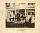 "Group on the Porch Major General George Armstrong Custer's Headquarters Near Winchester, Virginia. LIBI_00019_00258; An albumen photograph, ""Maj. Gen. Custer's headquarters, near Winchester, VA""; mounted on card; by Boulsby; dated circa 1864. ; Print, Photographic [mounted on card]; Courtesy of the National Park Service, Little Bighorn Battlefield National Monument, LIBI_00019_00258, Boulsby, ""Group on the Porch Major General George Armstrong Custer's Headquarters Near Winchester, Virginia,"" circa 1864"