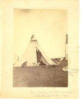 "George Armstrong Custer in the Mouth of a Tent with His Dogs and Pet Pelican During the Washita Campaign. LIBI_00019_00576; This item is an original albumen, card-mounted photograph of George A. Custer standing in the opening of a tent during the Washita Campaign.  Custer's 3 greyhounds and stag hound are also visible laying outside the tent and his pet pelican is partially visible on the lower right edge of the image.  The full view photograph is 5 1/2 x 7 7/8"" (8 x 10 1/16"" mounted) and was produced circa 1868.  The photographer is possibly W.S. Soule.  On the front, a handwritten notation reads, ""Gen. Custer at the Washita/[illegible words]/2 [illegible words] Scotch Stag.""  On the verso, a handwritten notation reads, ""Autie near Ft. Dodge Kansas.""  Handwritten description on the verso provided by Elizabeth B. Custer.Note: ""Additions/Box 7"" handwritten on the verso.  Photograph reprinted in ""The Custer Album"" by Lawrence A. Frost, page 106.; Print, Photographic [Mounted on Card]; Courtesy of the National Park Service, Little Bighorn Battlefield Nation"