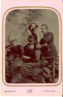 "George Armstrong Custer in Civilian Dress with Three Women. LIBI_00019_00276; This item is an original tintype of George A. Custer in civilian dress and 3 women.  The collodion emulsion image is of Custer in standing view is 4 3/8 x 6 3/4"" and mounted in the original pink paper folder.  The image was produced circa 1875 by Edward M. Estabrooke of New York City.  On the front, a typed notation reads, ""Estabrooke, 31 Union Square.""  On the verso, a handwritten notation in pencil reads, ""For Libbie dear, Gen. Custer & his [illegible words] N.Y. [illegible words] May 8th, 1875.""Note: ""Pkg 4"" handwritten on verso.  Photograph reprinted in ""Custer in Photographs"" by D. Mark Katz, page 119.; TINTYPE [Photograph]; Courtesy of the National Park Service, Little Bighorn Battlefield National Monument, LIBI_00019_00276, Edward M. Estabrooke, ""George Armstrong Custer in Civilian Dress with Three Women,"" circa 1875"