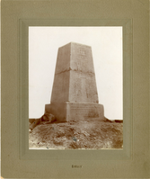 "View of the Memorial on Custer Hill. LIBI_00312_11274; ONE ALBUMEN CABINET VIEW OF THE MEMORIAL ON CUSTER HILL. PORTIONS OF FOUR PEOPLE AND ONE DOG HAVE BEEN BLOCKED OUT.; Album, Photograph;Courtesy of the National Park Service, Little Bighorn Battlefield National Monument, LIBI_00312_11274, Unknown Photographer, ""View of the Memorial on Custer Hill,"" date unknown"