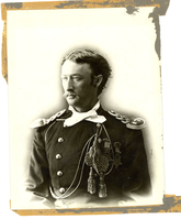 "First Lieutenant Thomas Ward Custer in Full Dress Uniform. LIBI_00011_07101; A black-and-white photograph of Tom Custer as 1st Lt. In full-dress uniform wearing his 2 Medal of Honors; photographer is unknown, circa 1873-1875; reverse has D. F. Barry label.  [note: Captain Custer was killed while commanding Company C.]; PRINT, PHOTOGRAPHIC; Courtesy of the National Park Service, Little Bighorn Battlefield National Monument, LIBI_00011_07101, D. F. Barry, ""First Lieutenant Thomas Ward Custer in Full Dress Uniform,"" circa 1873-1875"