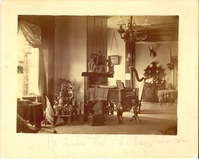 "Interior of the Custer Home at Fort Abraham Lincoln Showing a Harp and Piano. LIBI_00019_00580; This item is an albumen, card-mounted photograph of the interior of the Custer home at Fort Abraham Lincoln.  The full view photograph is 7 15/16 x 10"" mounted and was produced circa 1875 by an unknown photographer.  On the front, a handwritten notation reads, ""Hd Quarters Fort Abraham Lincoln 1875.""  Slight foxing is evident on the verso.Note: ""Box 7"" handwritten on the verso. Photograph reprinted in ""The Custer Album"" by Lawrence A. Frost, page 41.; Print, Photographic [Mounted on Card]; Courtesy of the National Park Service, Little Bighorn Battlefield National Monument, LIBI_00019_00580, Unknown Photographer, ""Interior of the Custer Home at Fort Abraham Lincoln Showing a Harp and Piano,"" circa 1875"
