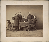 "Portrait of Officers: General Phillip Henry Sheridan, Lewis Merritt, George Armstrong Custer, James A Forsyth, and Thomas C. Devin Seated Around an Empty Table. LIBI_00019_00261; A photograph [albumen print] mounted on card, of a group of officers, Generals P. H. Sheridan, Lewis Merritt, George A. Custer, James Forsyth, Thomas Devin; by unknown photographer; dated circa 1864.; PRINT, PHOTOGRAPHIC [Mounted on card]; Courtesy of the National Park Service, Little Bighorn Battlefield National Monument, LIBI_00019_00261, Unknown Photographer, ""Portrait of Offices: General Phillip Henry Sheridan, Lewis Merritt, George Armstrong Custer, James A. Forsyth, and Thomas C. Devin Seated Around an Empty Table,"" circa 1864."