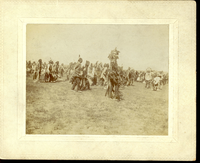 "Crow Indians Dance, Perhaps the War Dance at Fort Custer, Montana. LIBI_00251_07816; A cabinet photograph is 5 1/2"" x 4 1/2"". This image depicts a group of Crow in ceremonial dress. A handwritten note on verso reads: ""Crow Indians 'War Dance' at Fort Custer, Mont."" It was taken by an unknown photographer circa 1897. This image is in good condition. ; photograph;  Courtesy of the National Park Service, Little Bighorn Battlefield National Monument, LIBI_00251_07816, Unknown Photographer, ""Crow Indians Dance, Perhaps the War Dance at Fort Custer, Montana,"" circa 1897."