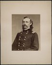 "Portrait of Brigadier General George Armstrong Custer Seated. LIBI_00019_00275; An albument photograph (toned), mounted on card, portrait Brigadier General George A. Custer; by Matthew Brady; dated circa 1864. ; Print, Photographic [Mounted on Card]; Courtesy of the National Park Service, Little Bighorn Battlefield National Monument, LIBI_00019_00275, Mathew B. Brady, ""Portrait of Brigadier General George Armstrong Custer Seated,"" circa 1864"