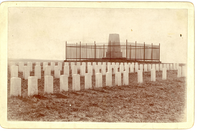"Rows of Headstones Near the Custer Monument. LIBI_00300_10573; A black & white photo mounted on cardboard. The image depicts the Custer Monument with the iron fence around it. There are sixty-six headstones arranged in rows in front of the monument. A handwritten note on the verso reads: Custer Battle Field 1897 N Trall Parrom"". The photo was taken by Mr. Krotzenberg in 1897. ; photograph; Courtesy of the National Park Service, Little Bighorn Battlefield National Monument, LIBI_00300_10573, Krotzenberg, ""Rows of Headstones Near the Custer Monument,"" 1897."
