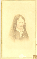 "Portrait in Bust View of Elizabeth Bacon Custer with Tinted Cheeks. LIBI_00295_10695; Albumen photo pasted to card. A portrait of Elizabeth Custer in bust view.  She is wearing a dark dress with a white color and a dark lace veil. Her cheeks have been dark dress, white collar, dark lace vail, cheeks touched up with red tint. The card has a gold border. The bottom center and right corner of the card and photo have tears. On the verso, is a stamp in violet from the Junction City Gallery of Art, S. Meixsell, Proprietor. A stain in the upper right corner may be from glue removal. The photo was produced by S. Meixsell, circa 1862. ; photograph;  Courtesy of the National Park Service, Little Bighorn Battlefield National Monument, LIBI_00295_10695, S. Meixsell, ""Portrait in Bust View of Elizabeth Bacon Custer with Tinted Cheeks,"" circa 1862."