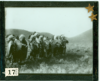 "Group of Native Americans in Full Regalia at the 10th Anniversary of the Battle of Little Bighorn. LIBI_00030_01324; A lantern-slide (glass transparency), ""Tenth Anniversary of Custer Fight"". It depicting a group of Native Americans in full regalia and feathered headdresses. It was produced by an unknown photographer in 1886. [Bowen no. 17; picture file & negative.]; transparency, latern-slide [photographic material];  Courtesy of the National Park Service, Little Bighorn Battlefield National Monument, LIBI_00030_01324, Unknown Photographer, ""Group of Native Americans in Full Regalia at the 10th Anniversary of the Battle of Little Bighorn,"" 1886"
