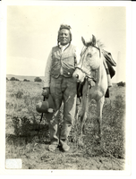 "Curly Holding a White Horse. LIBI_00030_00694; A black-and-white photograph of Curley, Crow Scout, one of Custer's favorite scouts; full size view with white horse; Curley standing with high crowned hat and quirt in right hand, left hand grasping halter rope. On reverse side of photograph is written information (in ink), ""Curly, one of [George A. ] Custer's Indian scouts taken on Custer battlefield in 1913 by E. A. Brininstool. Curley died may 22, 1923.""; print, photographic;  Courtesy of the National Park Service, Little Bighorn Battlefield National Monument, LIBI_00030_00694, E. A. Brininstool, ""Curly Holding a White Horse,"" 1913"
