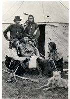 "Lieutenant Colonel George Armstrong Custer Seated in Front of a Tent with Three Indian Scouts and John Burkman. LIBI_00312_11106; Photo print. This image depicts Lieutenant Colonel George Armstrong Custer. He is seated outside a tent with three Indian Scouts and his striker, John Burkman. Bloody Knife is kneeling on Custer's right. A paper lies across Custer's lap. The guide on Custer's left points at it. A rifle, bullets and knife lay beside this man. A dog lies in the lower left corner. This image was taken by an unknown photographer, probably in 1873, during the Yellowstone Campaign. It is identical to LIBI_0312_13448. ; print;Courtesy of the National Park Service, Little Bighorn Battlefield National Monument, LIBI_00312_11106, Unknown Photographer, ""Lieutenant Colonel George Armstrong Custer Seated in Front of a Tent with Three Indian Scouts and John Burkman,"" circa 1873."
