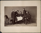 "Portrait of Officers: General Phillip Henry Sheridan, Lewis Merritt, George Armstrong Custer, James A Forsyth, and Thomas C. Devin Examining a Document. LIBI_00019_00262; A photograph [albumen print] mounted on card, of a group of officers, Generals P. H. Sheridan, Lewis Merritt, George A. Custer, James Forsyth, Thomas Devin; by unknown photographer; dated circa 1864.(note: right edge a 2 inch tear backed with tape. 12/3/90 DSO) ; PRINT, PHOTOGRAPHIC [Mounted on card]; Courtesy of the National Park Service, Little Bighorn Battlefield National Monument, LIBI_00019_00262, Unknown Photographer, ""Portrait of Offices: General Phillip Henry Sheridan, Lewis Merritt, George Armstrong Custer, James A. Forsyth, and Thomas C. Devin Examining a Document,"" circa 1864."