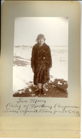 "Two Moon, Chief of Northern Cheyennes in a Bear Skin Coat. LIBI_00268_07953; A 6 5/8"" x 4 1/2"" mounted on a 10"" x 7 3/4 "" card. The photograph depicts Two Moon (Northern Cheyenne) standing in snow.  He is wearing a bear skin coat and fur hat.  The image was taken on the Crow Agency, Montana. A handwritten note on the edge of the card reads:  ""Two Moon, Chief of Northern Cheyennes Leader against Custer June 25, 1867"". The image is in good condition. It was taken by Fred E. Miller, circa 1898.   (The photographer was identified by Toddy Munson on 8/5/1996, note made by K.B.D); photograph;  Courtesy of the National Park Service, Little Bighorn Battlefield National Monument, LIBI_00268_07953, Fred E. Miller, ""Two Moon, Chief of Northern Cheyennes in a Bear Skin Coat,"" circa 1898."
