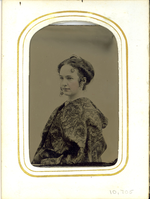"Tintype Portrait of Elizabeth Bacon Custer Draped in Floral Pattered Cloth. LIBI_00295_10705; Tintype portrait of Libbie Custer in left profile and pull bust view. She is draped in a floral pattered cloth. Her hair is pulled back and curled. The image is very similar to LIBI_00295_10702 and LIBI_00295_10703. There is no visible damage on the photograph. The image was taken by an unknown photographer on an unknown date. ; photograph ;  Courtesy of the National Park Service, Little Bighorn Battlefield National Monument, LIBI_00295_10705, Unknown Photographer, ""Tintype Portrait of Elizabeth Bacon Custer Draped in Floral Pattered Cloth,"" date unknown"