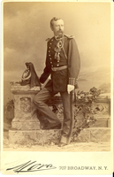 "Lieutenant Colonel George Armstrong Custer in Full Military Dress Beside a Wall. LIBI_00019_00289; This item is an albumen cabinet card (card-mounted photograph) of Lieutenant Colonel George A. Custer in standing view and wearing full dress uniform.  The photograph is 4 x 5 1/2"" (4 1/4 x 6 1/2"" mounted) and was produced circa 1875 by Jose M. Mora of New York.  The photographer's stamp is printed on the front.Note: ""Pkg 4"" handwritten on the verso. Photograph reprinted in ""Custer in Photographs"" by D. Mark Katz, page 134.; Cabinet Card [Card Photography]; Courtesy of the National Park Service, Little Bighorn Battlefield National Monument, LIBI_00019_00289, Jose M. Mora, ""Lieutenant Colonel George Armstrong Custer in Full Military Dress Beside a Wall,"" circa 1875"