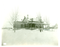"General George Armstrong Custer Home in the Snow, Fort Abraham Lincoln, North Dakota. LIBI_00030_00766; A black-and-white photograph depicting a view of General George A. Custer's quarters at Fort Abraham Lincoln, North Dakota. The house is covered in snow and there is a figure in heavy clothes in front of the house. A handwritten pencil notation on verso reads: ""Gen Custer Home-at Fort a. Lincoln, N. Dak"" Produced by D. F. Barry on an unknown date. ; print, photographic;  Courtesy of the National Park Service, Little Bighorn Battlefield National Monument, LIBI_00030_00766, D. F. Barry, ""General George Armstrong Custer Home in the Snow, Fort Abraham Lincoln, North Dakota,"" date unknown"