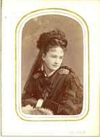 "Portrait of Elizabeth Bacon Custer in Mourning Clothes, Including a Hat with a Veil. LIBI_00295_10708; An albumen portrait of Libbie Custer. She is wearing mourning clothes: a hat with a chin strap and a veil attached to the back. Her dress is black, with laced sleeves and metal epaulets. She also wears black gloves. Her collar and cuffs are white. There is faint spotting throughout the image.On the verso, there a stamp in gold from: ""E. Klauber, photographer, Cor. Third & Jefferson Streets, Loiusville, KY"". This image was taken by E. Klauber on an unknown date. ; photograph ;  Courtesy of the National Park Service, Little Bighorn Battlefield National Monument, LIBI_00295_10708, E. Klauber, ""Portrait of Elizabeth Bacon Custer in Mourning Clothes, Including a Hat with a Veil,"" date unknown."