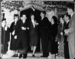 "Wedding of Jean Muir Hanna (only grand-daughter of John Muir) to Eugene de Lipkau at the LeConte Memorial Lodge, Yosemite. At left: Wanda Muir Hanna. The 3 Hanna sons at the right of Jean - Bob Hanna & fiancee (?), Mrs. John Hanna, John Hanna, & ""Strent"" Strentzel Hanna."
