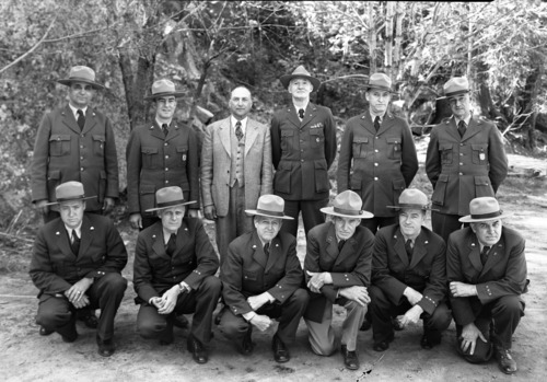 Superintendents at Yosemite Fire Conference for Region Four. L-R: back row- Preston Macy, Olympic; Jim Cole, Joshua Tree; Major Tomlinson, Regional Director; Colonel White, Sequoia; Ernest Leavitt, Crater Lake; Don Fisher, Lava Beds; Front- Harry Buckley, Silver Creek Rec. Area; John Preston, Mt. Ranier; Frank A. Kittredge, Yosemite; Ray Goodwin, Death Valley; Jimmy Lloyd, Lassen; Walter Finn, Muir Woods