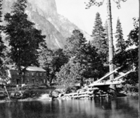 "Detail of L. Samus Stereo (RL-16,548). Caption: ""1621. Sentinel Rock, 3,270 feet high, Hutchings' Hotel, and the Merced River."" copied by Michael Dixon, copied July 1985"