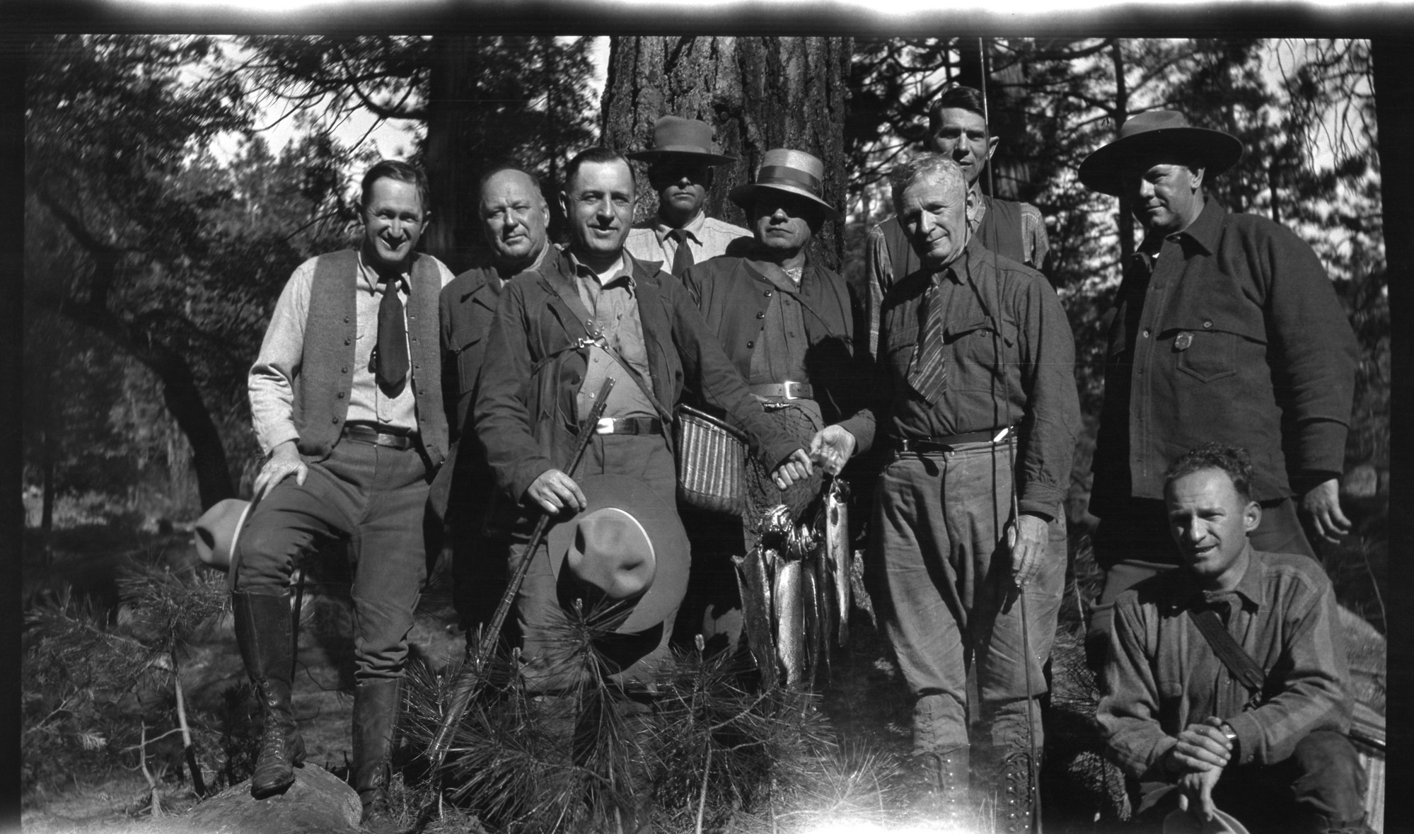 Horace Albright on left and Gov. C.C. Young in center without hat. Don Tresidder behind Young and Forest Townsley on right (standing).  Copy Neg: Mike Floyd, 9/91