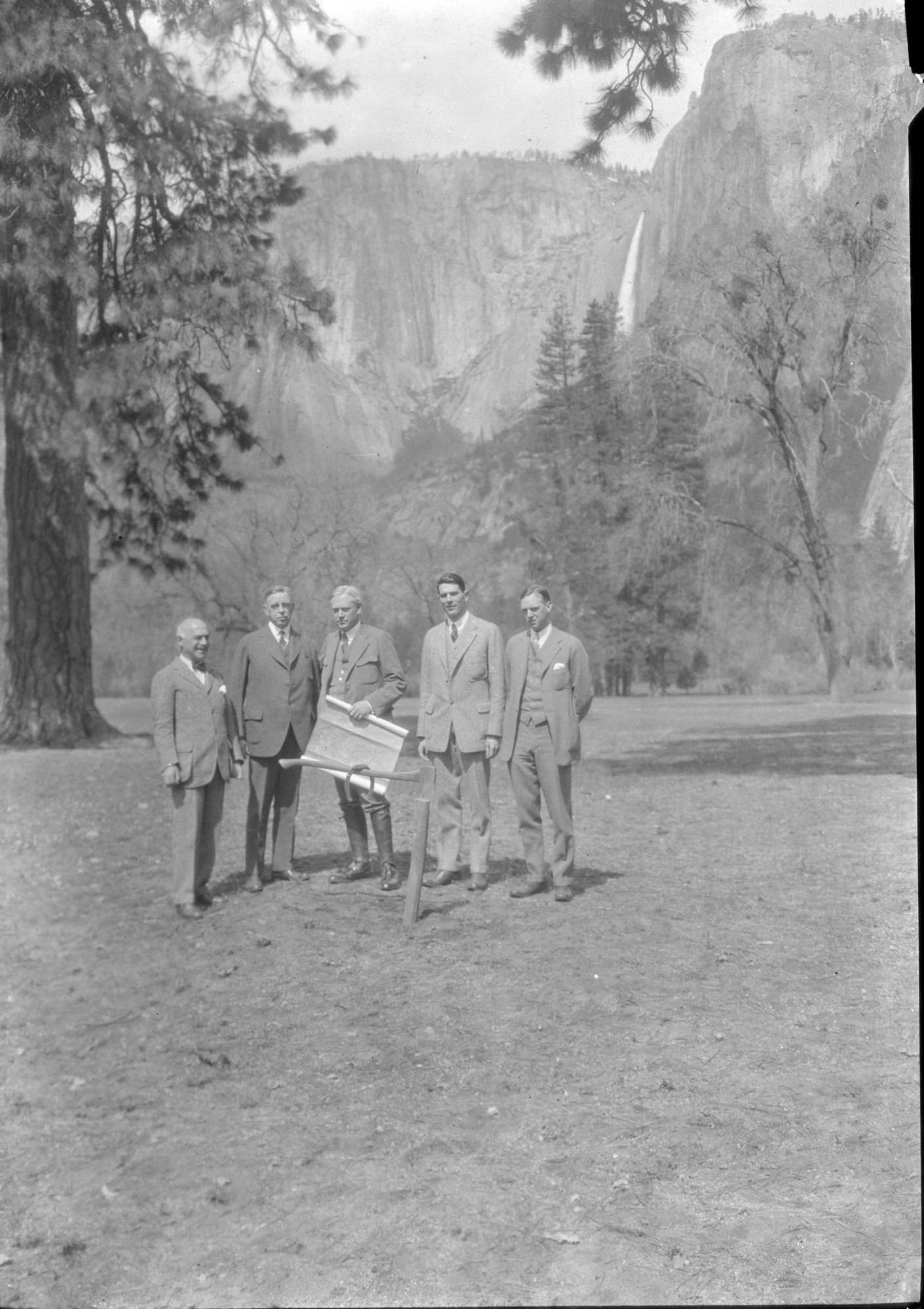 At site of future Ahwahnee Hotel: L-R: 1.? 2. Secty of Interior Hubert Work. 3. NPS Dir. Stephen T. Mather, 4. Donald Tresidder, 5. Bob Williams