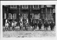 Mounted Rangers at Rear of Ranger's Club. [Far right: Chief Ranger Forest Townsley, 5th from right: Charles Adair (?), 2nd from left: Billy Nelson (?), Far left: Jack Gayler (?)]