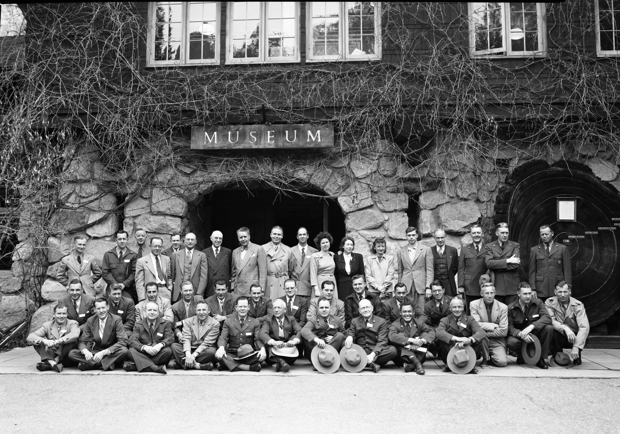 Group attending Region Four Naturalist Conference in Yosemite. April 14-17, 1948. LEFT TO RIGHT: FRONT ROW- Paul E. Schulz, Lassen; Howard R. Stagner, Sequoia; Russell K. Grater, Rainier; Geo. C. Rulhe, Crater Lake; Harry Parker, Yosemite; Clarence Fry, Sequoia; Leslie F. Keller, Death Valley; D.E. McHenry, Yosemite; Chas. H. Hembree, Death Valley; and Aubrey Houston, Death Valley. 2ND ROW- Don Erskine, Sequoia-Kings; Gunnar Fagerlund, Olympic; Sam J. Pusateri, Sequoia; Frank R. Givens, Joshua Tree; Merlin K. Potts, Mt. Rainier; Frank Bean, Mt. McKinley; Aubrey Neasham, Historian Region Four; Mahoney, Yosemite; Howard Powers, Hawaii; Robert McIntyre, Yosemite; and John Bingaman, Yosemite. STANDING- Norman Herkenham, Shasta Lake; Sam L. Clark, Yosemite; Dorr Yeager, Regional Naturalist; Odin Johnson, Yosemite; O.A. Tomlinson, Regional Director of Region Four; C.M. Goethe; John Doerr, Chief Naturalist; Carl Swartzlow, Regional Naturalist-Region 2; Lowell Sumner, Biologist; Margery Kennedy, Elizabeth Godfrey, He