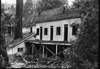 Rear view of Cedar Cottage during demolition.