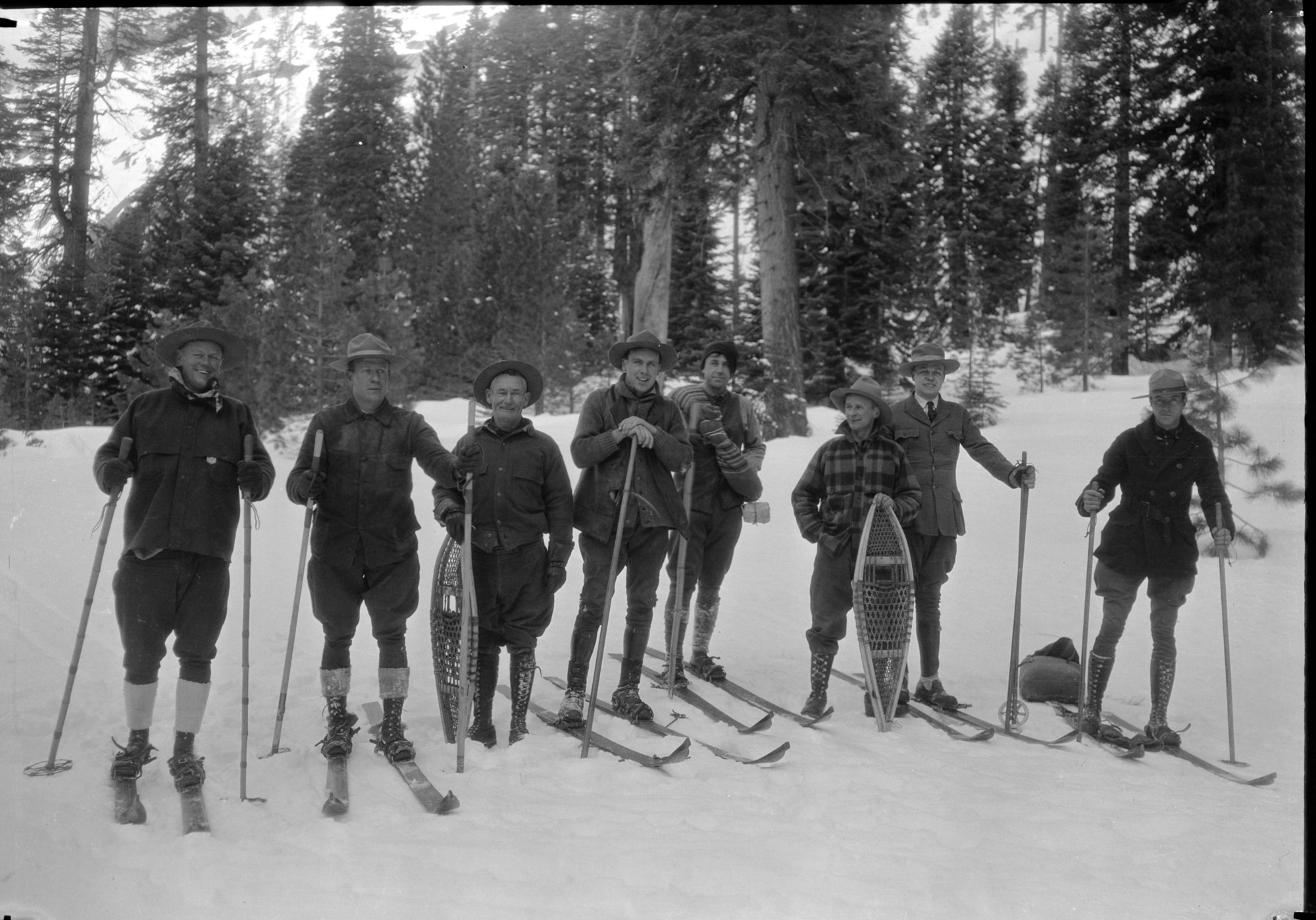 Ski party: L-R Chief Townsley, O.G. Taylor, Chas Adair, Dick Freeland, John Wegner, ?, Carl Russell, Sam Clark [attached to photo card] Stone Photo: Off for the High Sierra! This party insisted on penetrating the depths of the High Sierra even when blanketed with snow averaging from seven to eleven feet in depth. Skiis and snowshoes are the prevailing means of transportation in the High Sierra region surrounding Yosemite Valley after the snow begins to fall. From James V. Lloyd, Information Ranger, Yosemite National Park, Calif. Copy Neg: Leroy Radanovich, February 1998