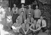 Supt. Russell and staff in front of Yosemite Museum after last staff meeting. LEFT TO RIGHT: Standing: Betty Koubelle, Homer Robinson, Carl Russell, E.C. Smith, Will Ellis. Kneeling: Emil Ernst, Duane Jacobs. Seated: Chas. F. Hill, Donald E. McHenry, Harthon L. Bill and Ralph H. Anderson.